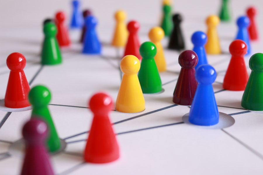 game pieces on a board - proven business system from truby achievements