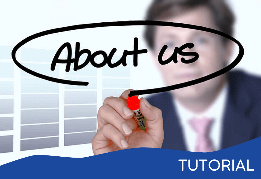 man writing about us on a glass board - featured image for a Team Roles and Responsibilities related tutorial from Truby Achievements