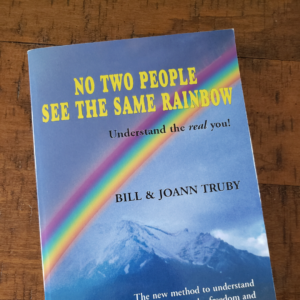 squared photo showing the cover of the No Two People See The Same Rainbow book by Truby Achievements - shows a rainbow over Mount Shasta