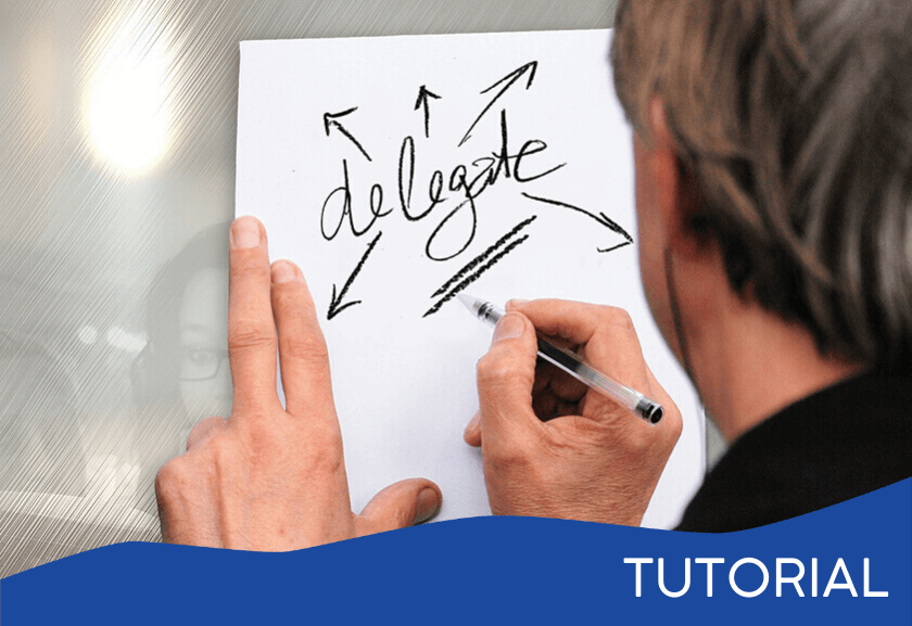 man writing delegate on white board - featured image for the Delegation System tutorial from Truby Achievements