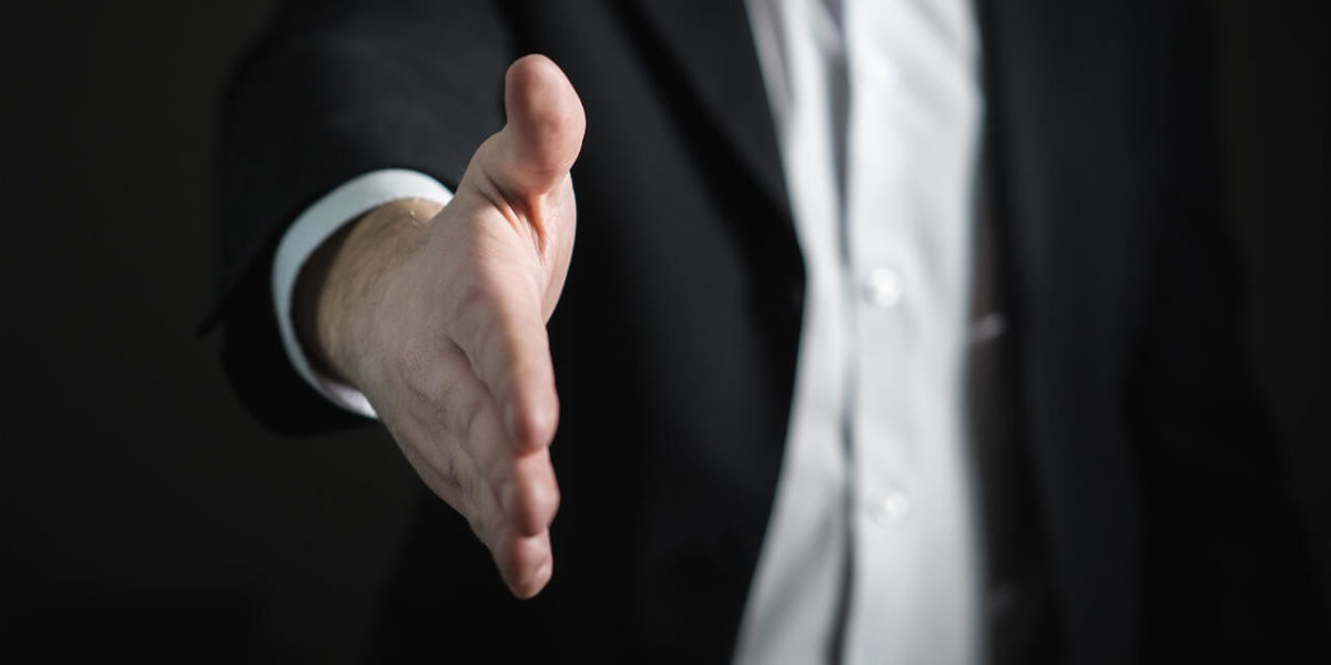 extended handshake representing effective hiring - from Effective Hiring – Nine Questions to Hire the Right Person for the Job article by Truby Achievements