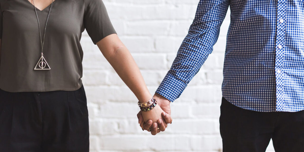 couple holding hands - from How to Start a Relationship Safely article by Truby Achievements