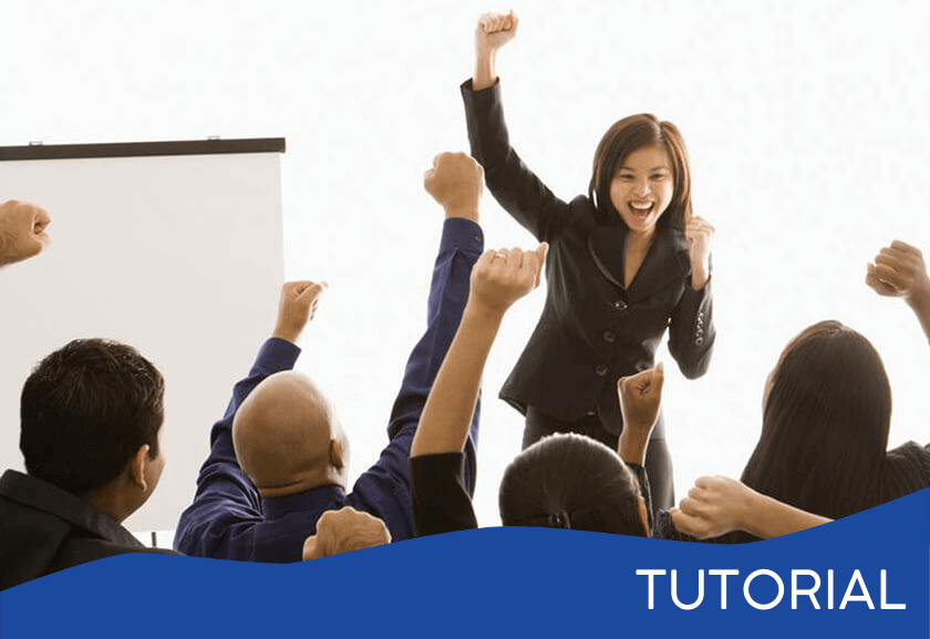 woman with arm raised cheering in front of a seated group doing the same thing - featured image for the Leaders Lead Toward Achievement tutorial from Truby Achievements