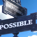 sign post saying impossible and possible representing conflict - for Manage and Resolve Conflict - A Six-Step Process article by Truby Achievement