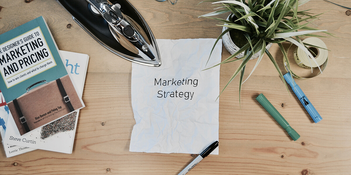 marketing strategy written on a piece of paper - from Marketing for a Nonprofit Organization article by Truby Achievements
