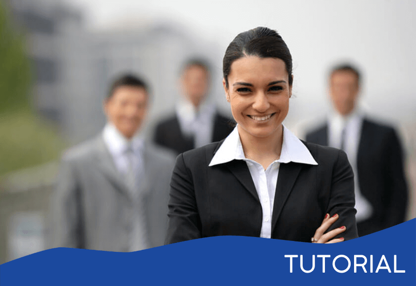 female manager with arms crossed in front of a group - featured image for the Championing tutorial from Truby Achievements