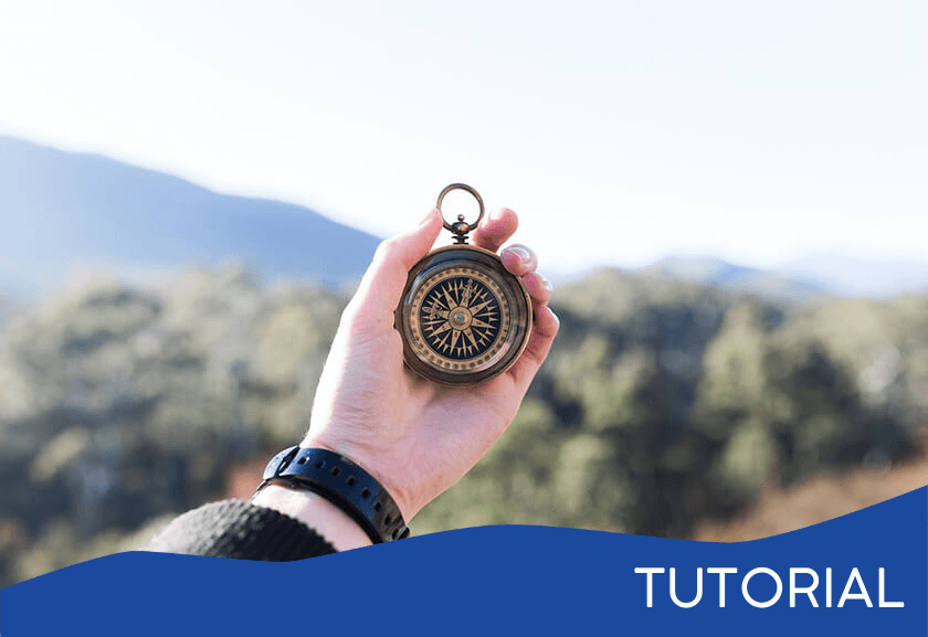 business man holding a compass up outside - featured image for the Discovering Your Purpose tutorial from Truby Achievements