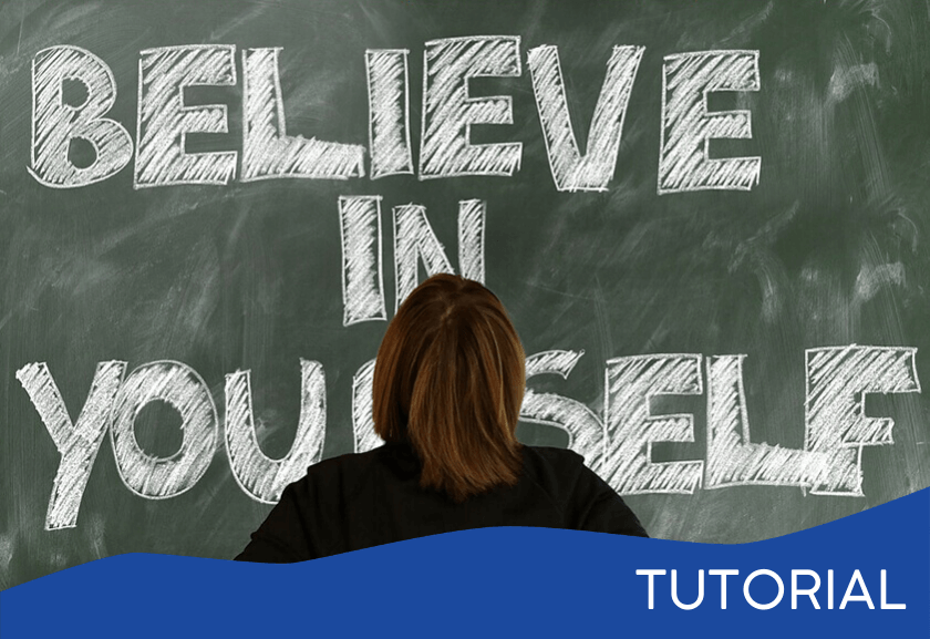 woman standing in front of a chalk board that says believe in yourself - featured image for the How To Have a Healthy Self-Esteem tutorial from Truby Achievements