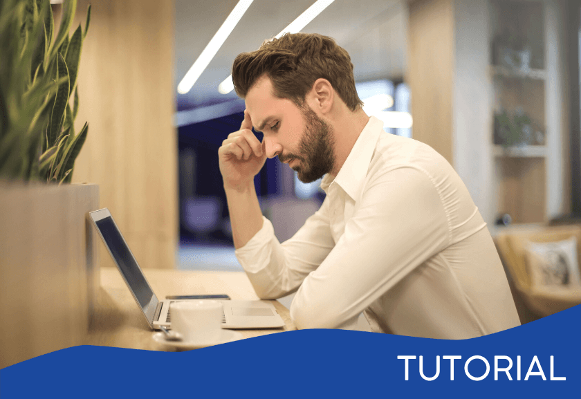 frustrated man sitting at his desk - featured image for the lack of follow through related tutorial from Truby Achievements