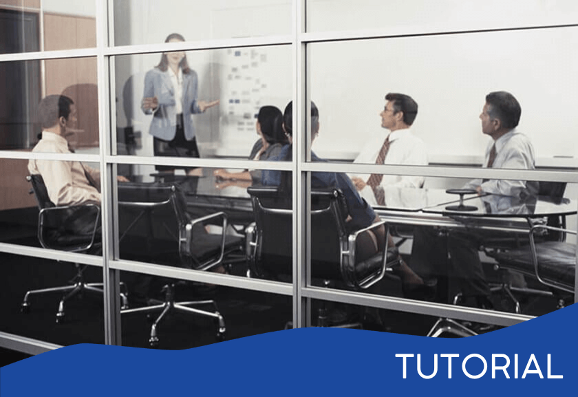 view into a glass conference room of people in a meeting - featured image for the Meeting Management tutorial from Truby Achievements