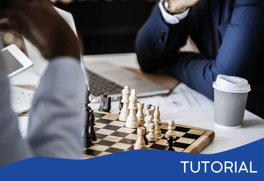 two business people playing chess - featured image for the Psychology of Play tutorial from Truby Achievements