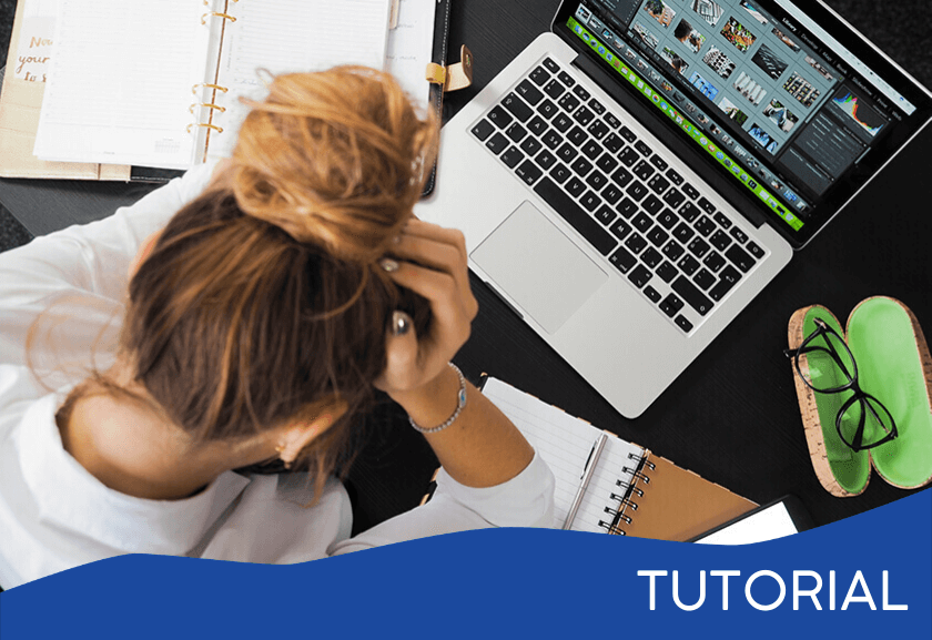woman holding her head in her hands - featured image for the Stress Management tutorial from Truby Achievements