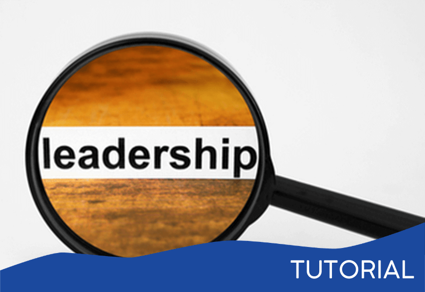magnifying glass showing leadership and wood background - featured image for the Top Leadership Traits tutorial from Truby Achievements