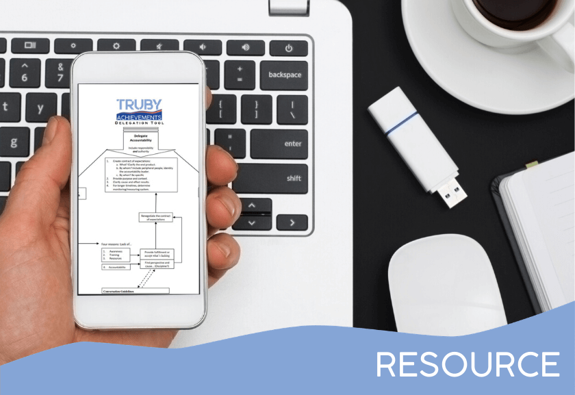 person holding a cell phone with mockup - featured image for Delegation Flow Chart - Tool from Truby Achievements, build your leadership skills
