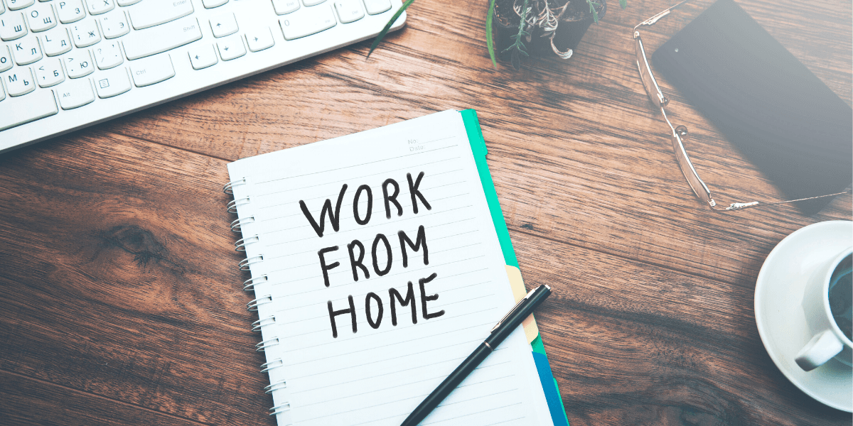 work from home written on a notebook for an article on sanity-saving tips for working from home from Truby Achievements blog