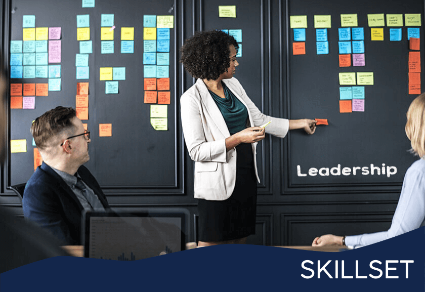 woman using sticky notes on a wall - featured image from leadership skills training skillset from truby achievements