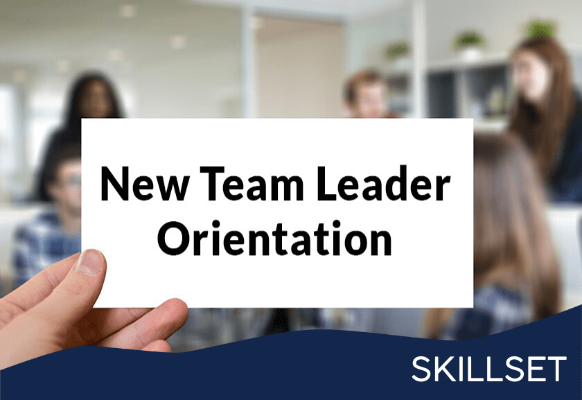 sign in front of a working team that says new team leader o0rientation - featured image for new team leader orientation skillset from truby achievements1