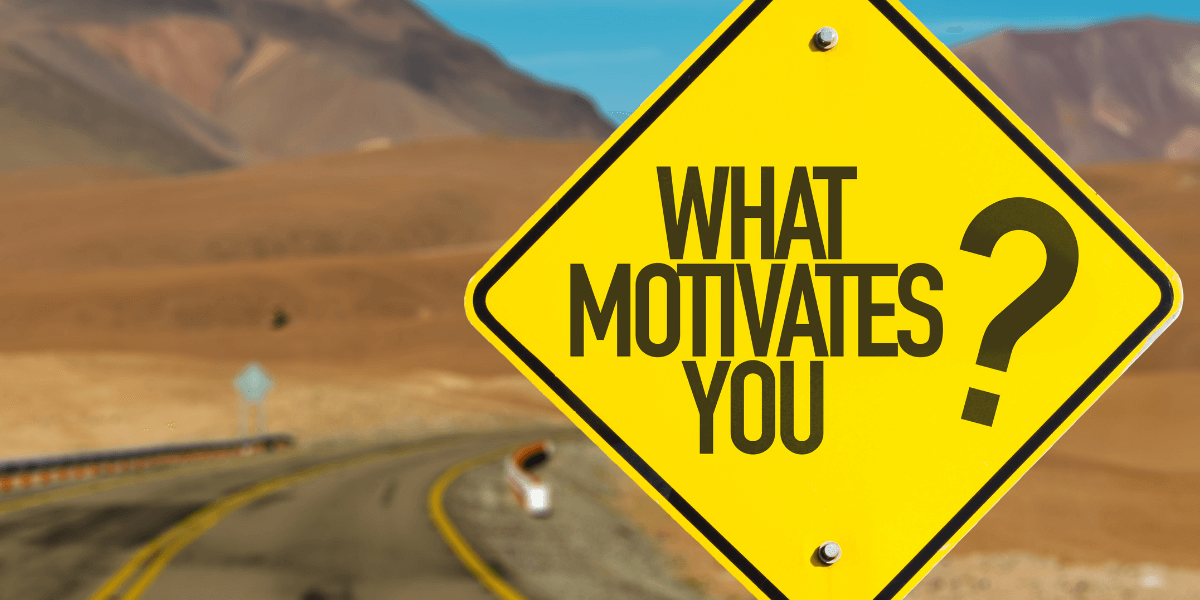 "yellow road sign that says ""what motivates you?"" - featured image for article from truby achievements - How to Improve Motivation by Understanding How Your Subconscious Ticks"