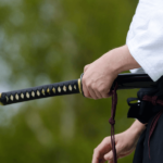 aikido master holding a sword - featured image for truby achievements article - Stop Negative Thoughts By Mental Martial Arts!
