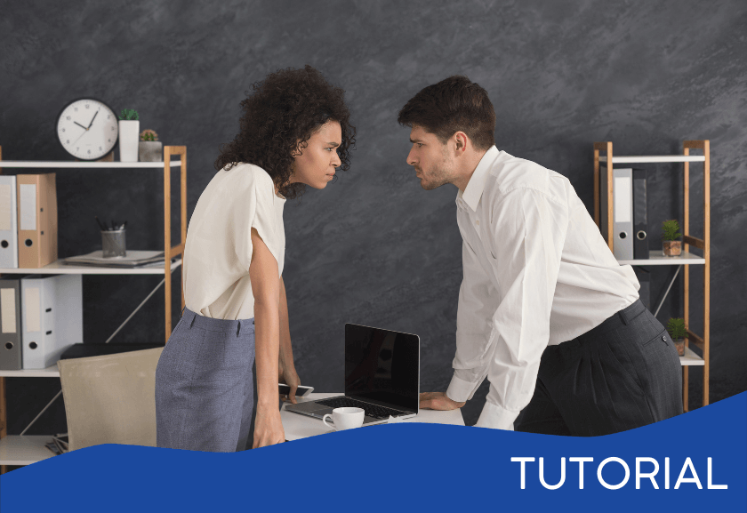 two colleagues starting at each other in conflict - featured image for conflict management tutorial from truby achievements