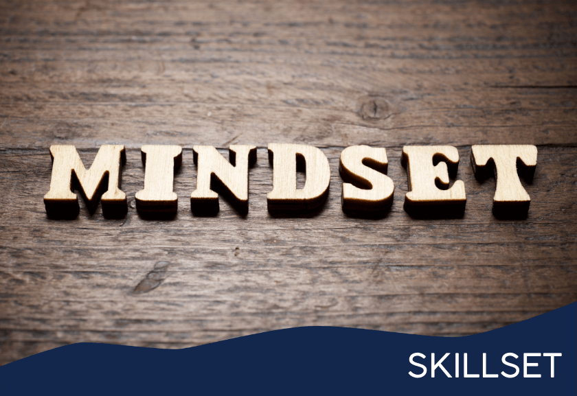 mindset in type set letters sitting on a wooden table - featured image for leadership mindset training - skillset from truby achievements membership